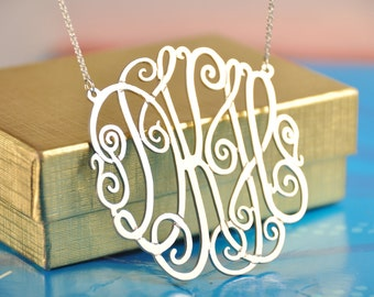 """sterling silver   monogram 1,5"""" diameter with a silver chain ."""