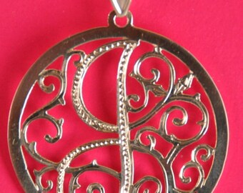 silver  initial necklace with cable chain.