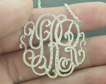 "monogram necklace  with 20cz set 1.25"" size , with a chain ."