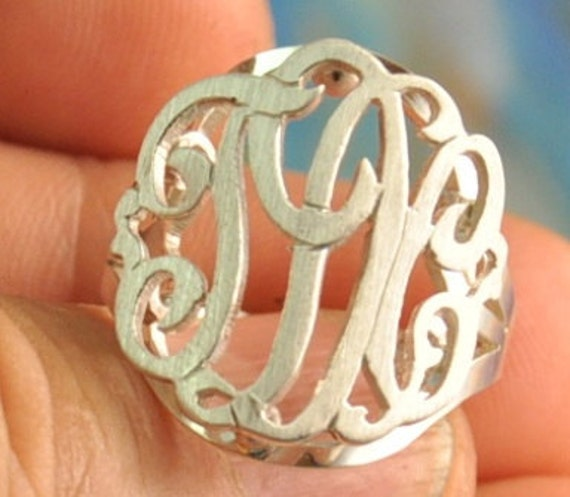 Monogram ring . sterling silver . Made from very thick gauge .