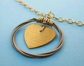 Love cymbal heart pendant