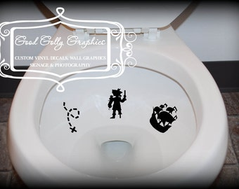 Taking Aim toilet targets Pirate 6 piece collection: pirate, ship, swords, skull and crossbones, helm and x marks the spot