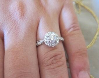 18k white gold Diamond flower engagement ring.