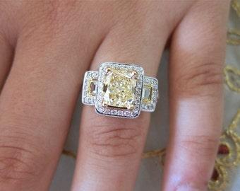 Yellow emerald cut diamond set on 18k white& yellow gold.