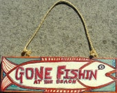 Gone-Related Sign - Gone Fishin' At The Beach - This sign with bright red lettering