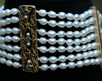 Solid Yellow Gold Striking Art Deco Pearl and Sapphire Bracelet. Perfect for Bridal Jewelry.