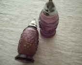 Purple glass salt and pepper shakers