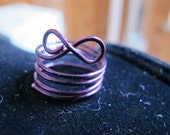 Wire wrapped infinity ring in purple, can be made in any size