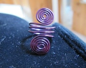 Wire wrapped ring double spirals in purple, can be made in any size