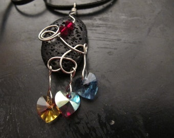 Hearts Afire:silver wire wrapped  lava stone pendant with Swarovski hearts