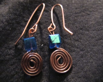 Wire wrapped earrings copper spirals blue crystals