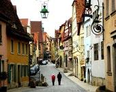 German Village - fine art travel photo of a german town in pastel hues - couple walking on cobblestone street. 8x10