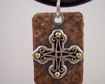 Hammered copper pendant with riveted sterling silver cross on black leather necklace