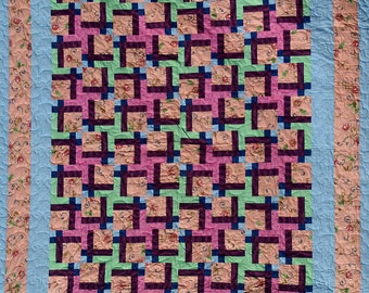 Queen size Colorful Twist and Turn Pinwheel Quilt, shades of pink, lime green, peach, navy, light blue.
