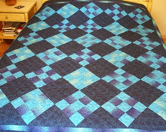 Full Size 9-Patch Quilt in blues and purples made by Vivian Ketron