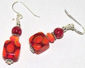 Orange dot and red Lampwork bead earrings