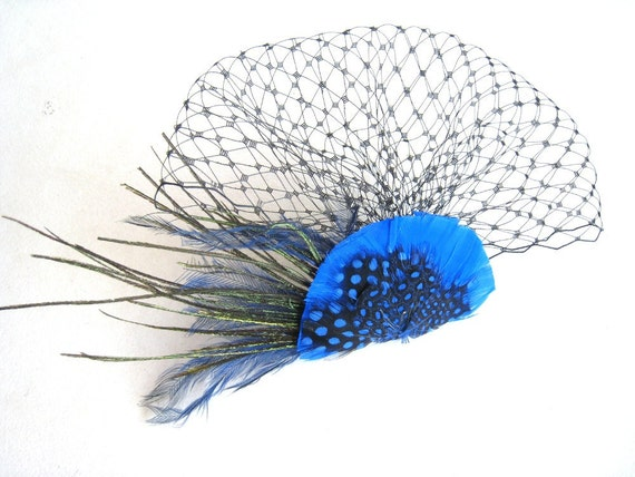 Bright blue birdcage veil and feather fascinator. Handmade by Bettina Millinery.