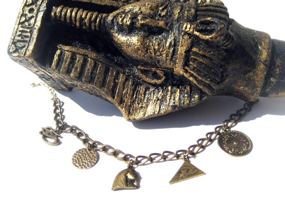 Vintage Egyptian charms bracelet all in bronze tone