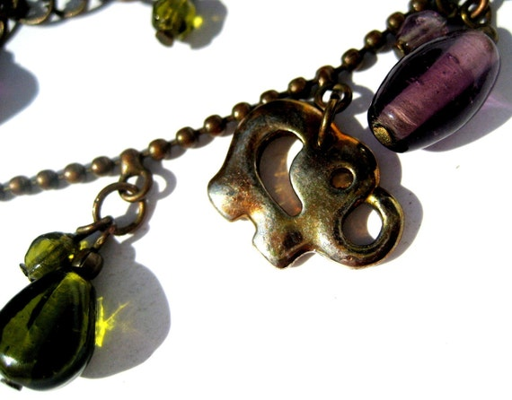 Vintage bronze tone necklace with dangling purple and green olive glass beads lucky elephants charms and glass pendant  Code U145