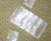 48 piece Hair combs clear plastic 2.74 inch wide wholesale priced hair combs