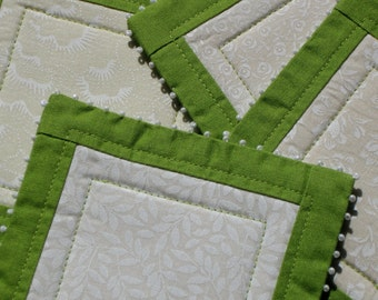 Spring green coaster set - cream and white mini prints patchwork coasters with spring green border and seed beads