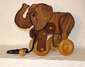 Animated wooden elephant pull toy.