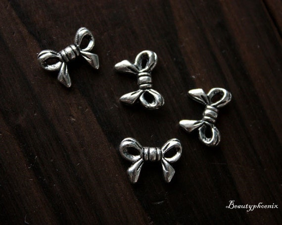 25pcs of Antiqued Silver Double-sided Lovely Little Bow Jewelry 22953