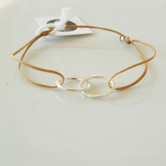 Infinity symbol bracelet on beige cord good karma by ...