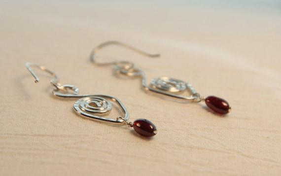 Abstract Silver Swans Garnet Earrings