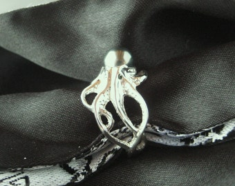 "an ""Octopus"" ring in Sterling Silver w/Tahitian Black pearl body and blue diamond eyes"