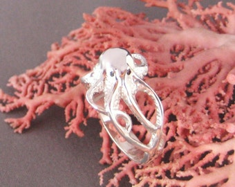 In the Depths/ Octopus ring in Sterling Silver w/Black Diamond eyes.