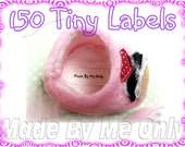 150 Labels Tiny White Clothing Iron on or Sewn in labels Great for HAIRBOWS,DOLL Clothes ,PURSES 1.5X.5 inches