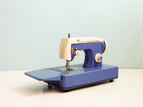 Vintage sewing machine working blue white russian