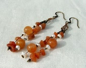 Soft orange adventurine womens earrings with antique brass