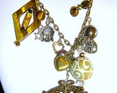 Abundance and Wealth.  Double fish carved jade talisman lariat with tiger eye, S Sea shell pearl, Buddha charm, hearts