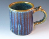 Mug With Pearly Blue Glaze And Red Glaze Running Down The Side