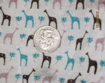 Cute, little giraffes in Teal, Mauve & Brown Giraffes on Rayon Jersey.  Knit Fabric