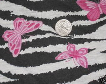 Pink Butterflies on Black/White Zebra Knit fabric