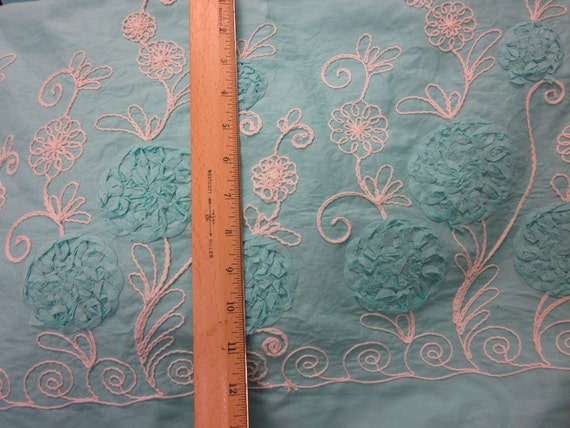 Gorgeous Ribbon Rosette with White Embroidery on Aqua Cotton - double Border woven