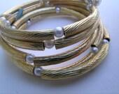 Saved for GINA Vintage Hattie Carnegie pearl spring bangle    VJSE