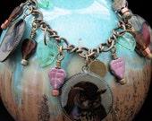 Charm Bracelet Vintage Bird Art in Resin Green Glass leaves Owl House Finch and Egret