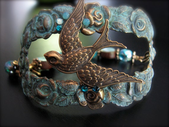 "Vintage Sparrow on Patina Frame of Roses Cuff with Ceramic beads and charms dangle ""Flight"" by Two Dragonflies"