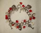 Hearts and Love - Red Charm Bracelet.  Crystal Beads and Beautiful hearts.  Make a great gift.