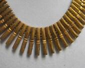 Vintage Art Deco Egyptian Revival necklace antique patina