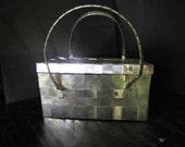 Woven metal handbag