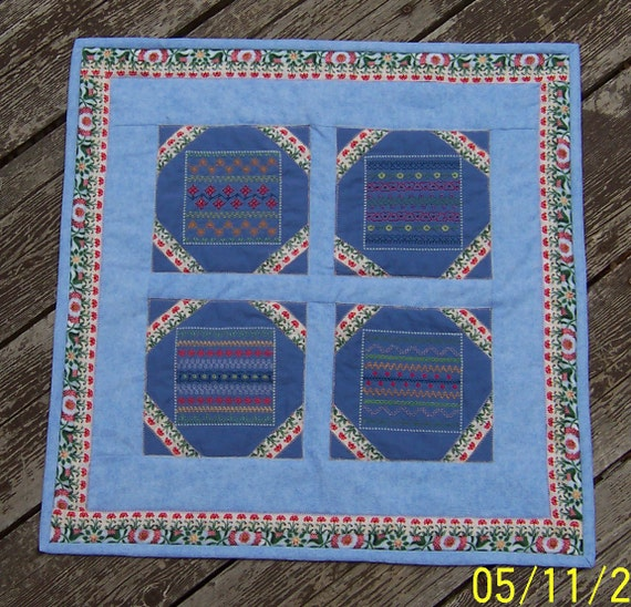 Quilted Table Topper Embroidered  Sampler Stitches appx 20x20 inches