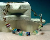 Glass Beaded Bracelet: Millefiori Bead and Bronze Bracelet, square beads seed beads primary colors