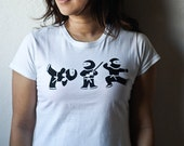 Women Ninja Tshirt (M). White cotton Lady Fit Tee screen printed with 3 ninjas in black ink