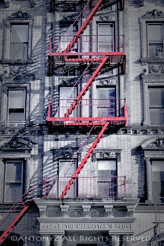 apartment building and red fire escape in the east village