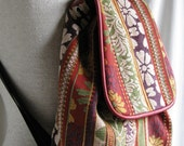 Tapestry backpack with red leather trim